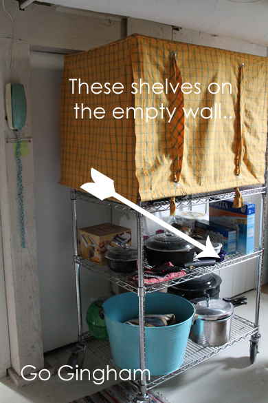 The shelves on the empty wall Go Gingham